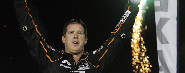 Jason Johnson celebrates after winning a dirt track race in Texas in 2012. (Getty Images)