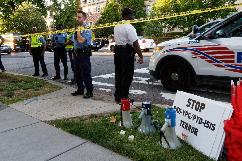 Police secure the street outside the Turkish embassy in Washington during a visit by Turkish President Recep Tayyip Erdogan on May 16, 2017, following an attack on protestors by members of Erdogan's security detail