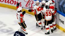 Flames eliminate Jets in Game 4