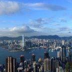 Hong Kong stocks post record close