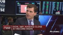 All major indexes close at record highs
