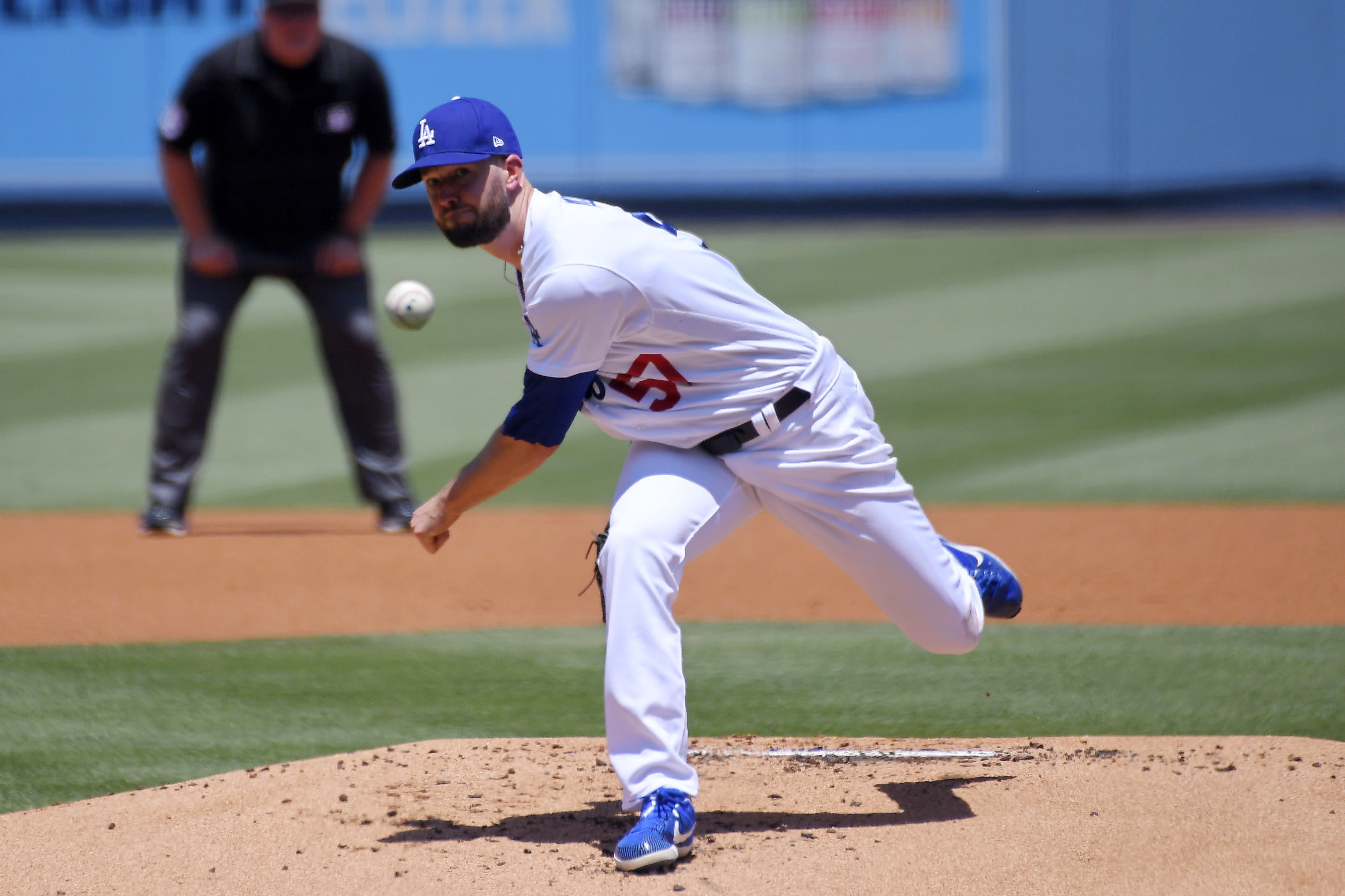 Los Angeles Dodgers starting pitcher Alex Wood throws to the plate during the first inning of a baseball game against the San Francisco Giants Saturday, July 25, 2020, in Los Angeles. (AP Photo/Mark J. Terrill)