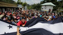Northbound migrant group doubles in size, enters Guatemala