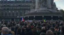 Protesters Gather in Paris' Place de la Republique in Support of Slain Teacher
