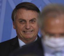 Brazil's Bolsonaro rejects COVID-19 shot, calls masks taboo