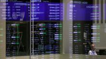 Asian shares tread water as investors watch trade talks
