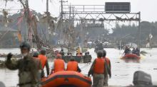 Nearly 40 feared dead as torrential rains hit southwest Japan