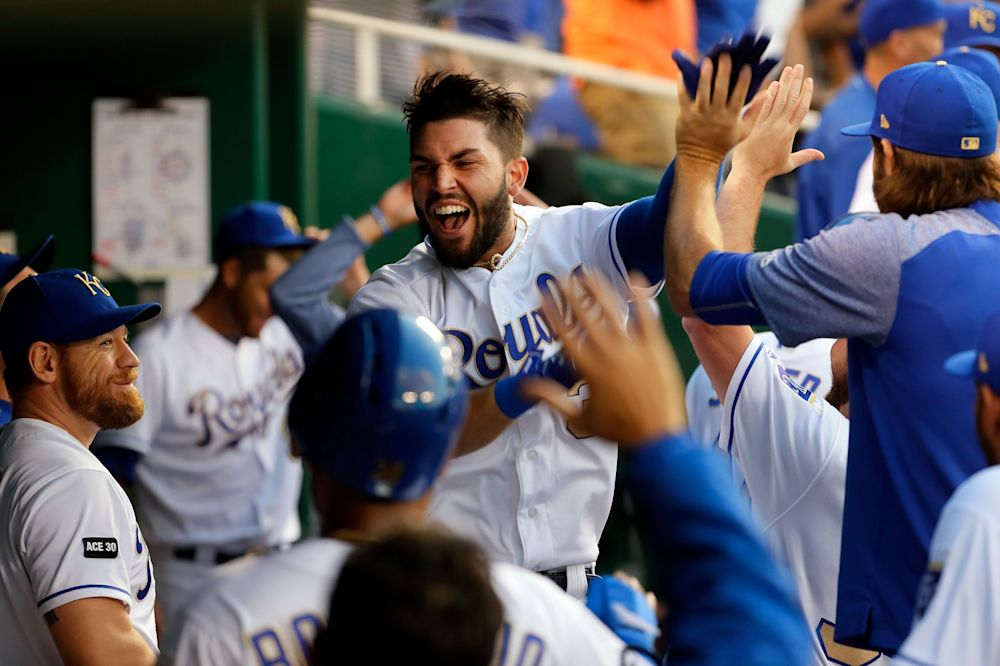 Eric Hosmer #35 of the Kansas City Royals is congratulated by teammates in the dugout after an official review confirmed he hit a three-run home run during the 4th inning of the game against the Minnesota Twins at Kauffman Stadium on June 30, 2017 in Kansas City, Missouri.