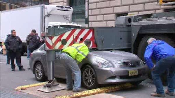 Out-of-control car crashes into crane