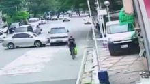 Lucky cyclist just inches away from being crushed by overturned minivan in the Philippines