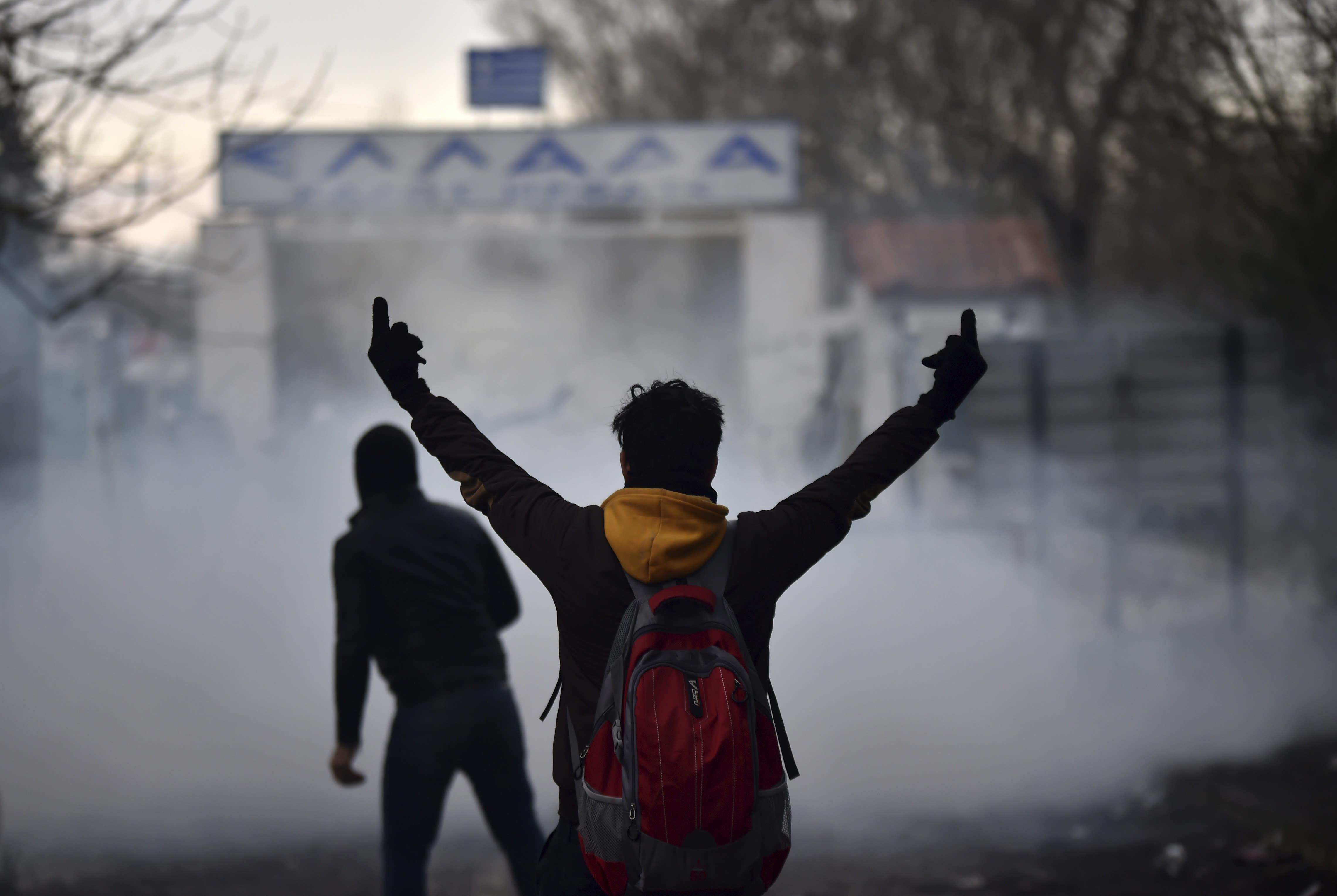 Greek border guard use teargas on migrants trying to enter Greece, at Pazarkule border gate, Edirne, Turkey, Saturday, Feb. 29, 2020. (Ismail Coskun/IHA via AP)
