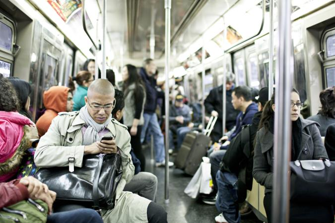 New York, USA - March 15, 2012: People traveling  in a busy subway train in New York city.