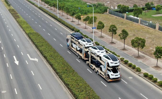 SHANGHAI, CHINA - JULY 11: Aerial view of new-energy vehicles sitting on a truck at Tesla Shanghai Gigafactory of Lingang New Area on July 11, 2021 in Shanghai, China. (Photo by VCG/VCG via Getty Images)