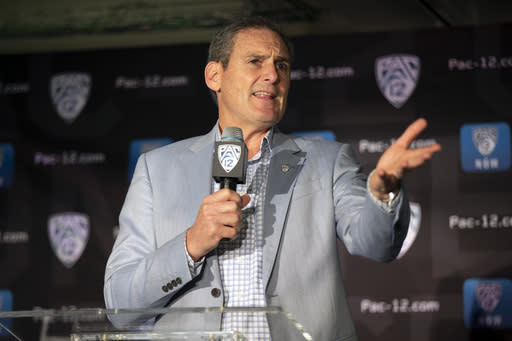FILE - In this Oct. 8, 2019, file photo, Commissioner Larry Scott speaks during the Pac-12 NCAA college basketball media day in San Francisco. After the Power Five conference commissioners met Sunday, Aug. 9, 2020, to discuss mounting concern about whether a college football season can be played in a pandemic, players took to social media to urge leaders to let them play. (AP Photo/D. Ross Cameron, File)