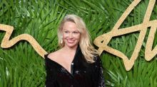 50-year-old Pamela Anderson sparkles in thigh-high split dress at Fashion Awards 2017