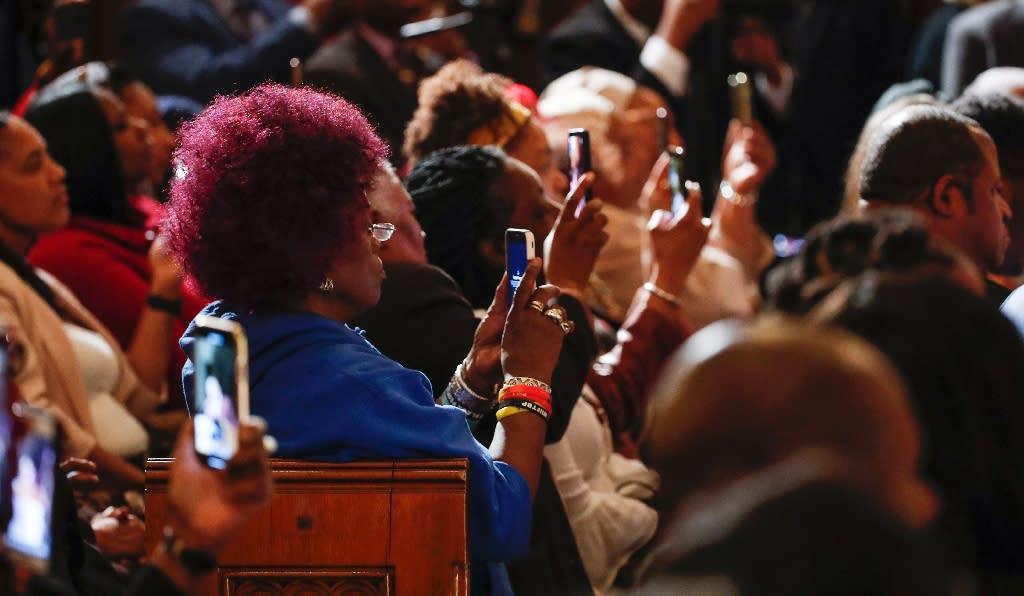 The congregation used smartphones to record Farrakhan as he spoke (AFP Photo/KAMIL KRZACZYNSKI)
