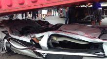 Passengers survive after car crushed flat as a pancake