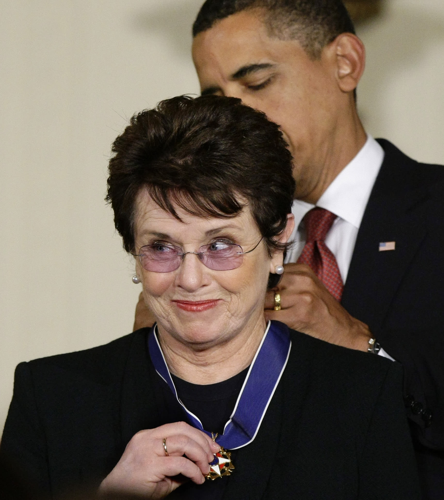 "FILE - In this Aug. 12, 2009 file photo, President Barack Obama presents the 2009 Presidential Medal of Freedom to Billie Jean King, known for winning the famous ""Battle of the Sexes"" tennis match, and championing gender equality issues, during ceremonies at the White House in Washington. King believes standing up to discrimination is the best way to combat it. She will help lead the U.S. delegation in the opening ceremonies at the Sochi Olympics in Russia, which recently passed an anti-gay law. (AP Photo/J. Scott Applewhite, File)"