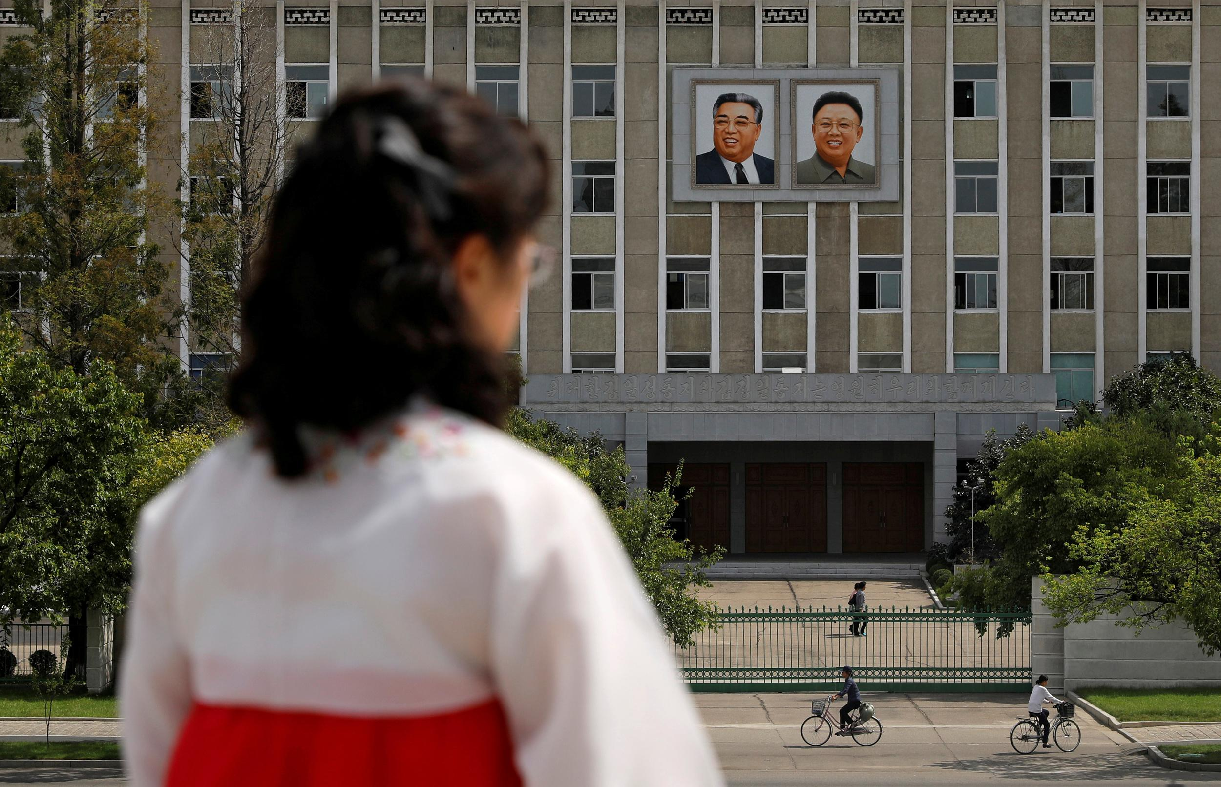 """Portraits of late North Korean leaders Kim Il Sung and Kim Jong Il are seen on the facade of a government building in Pyongyang, North Korea, September 11, 2018. REUTERS/Danish Siddiqui   SEARCH """"POY GLOBAL"""" FOR FOR THIS STORY. SEARCH """"REUTERS POY"""" FOR ALL BEST OF 2018 PACKAGES. TPX IMAGES OF THE DAY."""