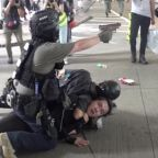 Officer Points Gun at Press and Bystanders During Arrest at Hong Kong Protests