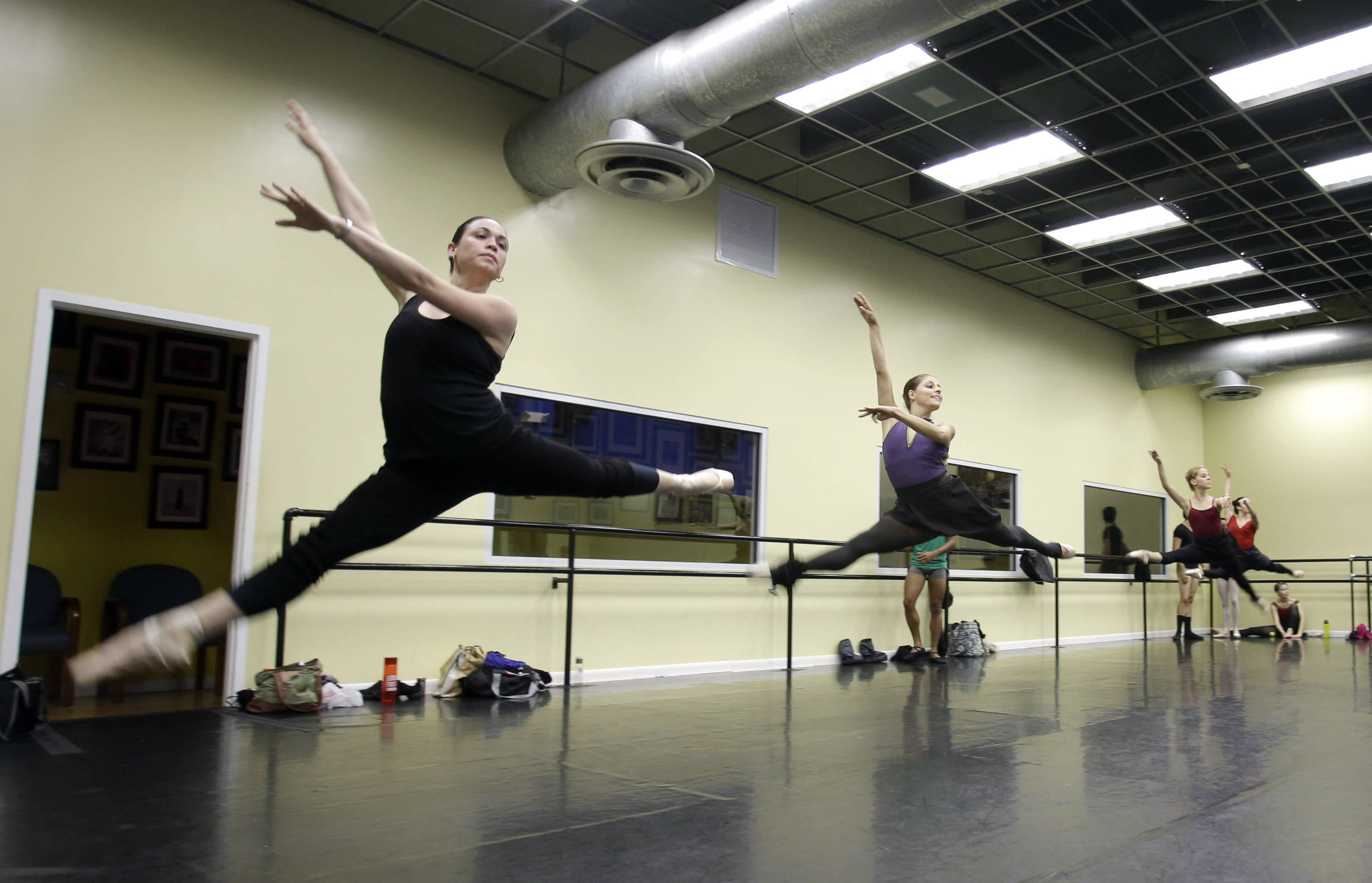 In this photo taken Friday, May 17, 2013, ballet dancers practice in a dance studio in Miami. These dancers could be among the young talent of any ballet company, but for the moment they are something else: Immigrants in the United States trying to land dancing opportunities while navigating cultural differences and learning English. The ballerinas fled from the Cuban National Ballet while on tour in Mexico in April, and crossed the border into Texas. (AP Photo/Alan Diaz)