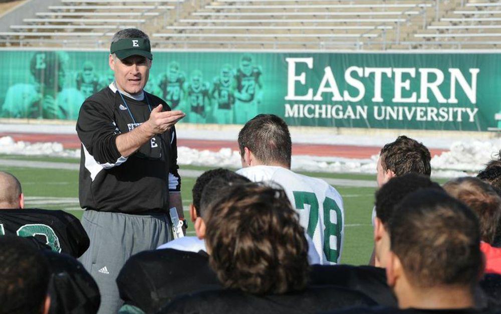 E Michigan to play football on concrete-gray turf