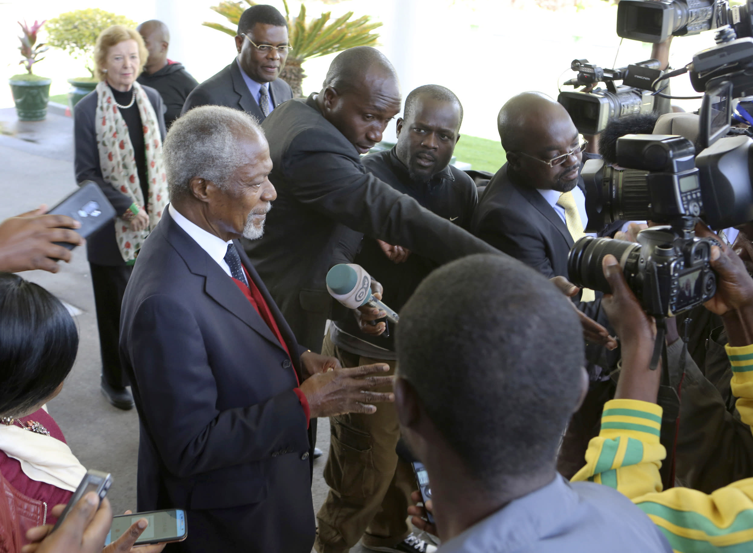 FILE - In this file photo dated Friday, July, 20, 2018, former United Nations Secretary General Kofi Annan, left, speaks to reporters after his meeting with Zimbabwean President Emmerson Mnangagwa at State House in Harare, Zimbabwe, as the country prepares to hold elections upcoming July 30. Annan, one of the world's most celebrated diplomats and a charismatic symbol of the United Nations who rose through its ranks to become the first black African secretary-general, has died aged 80, according to an announcement by his foundation Saturday Aug. 18, 2018.(AP Photo/Tsvangirayi Mukwazhi, FILE)
