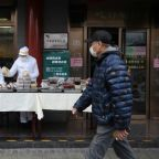 Fewer virus cases in China, but deaths abroad increase