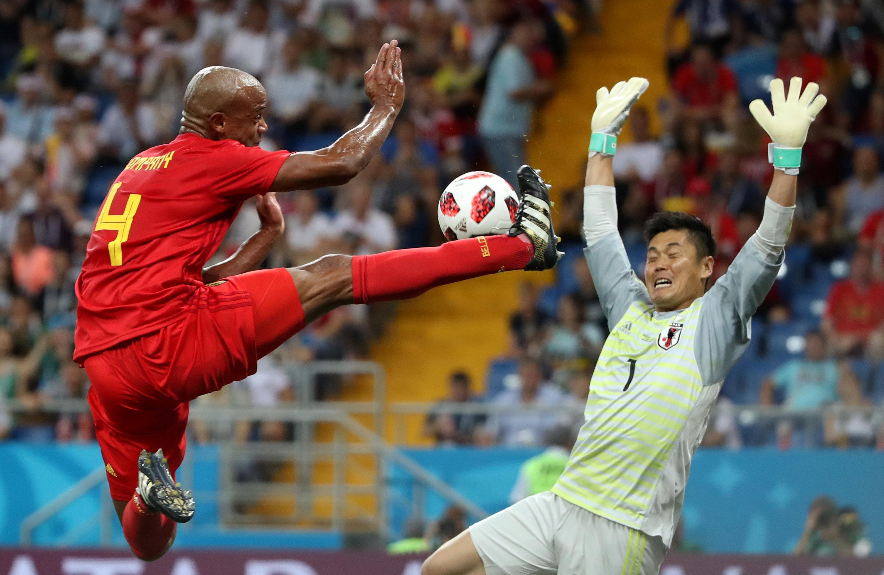 <p>Belgium's Vincent Kompany in action with Japan's Eiji Kawashima REUTERS/Marko Djurica </p>
