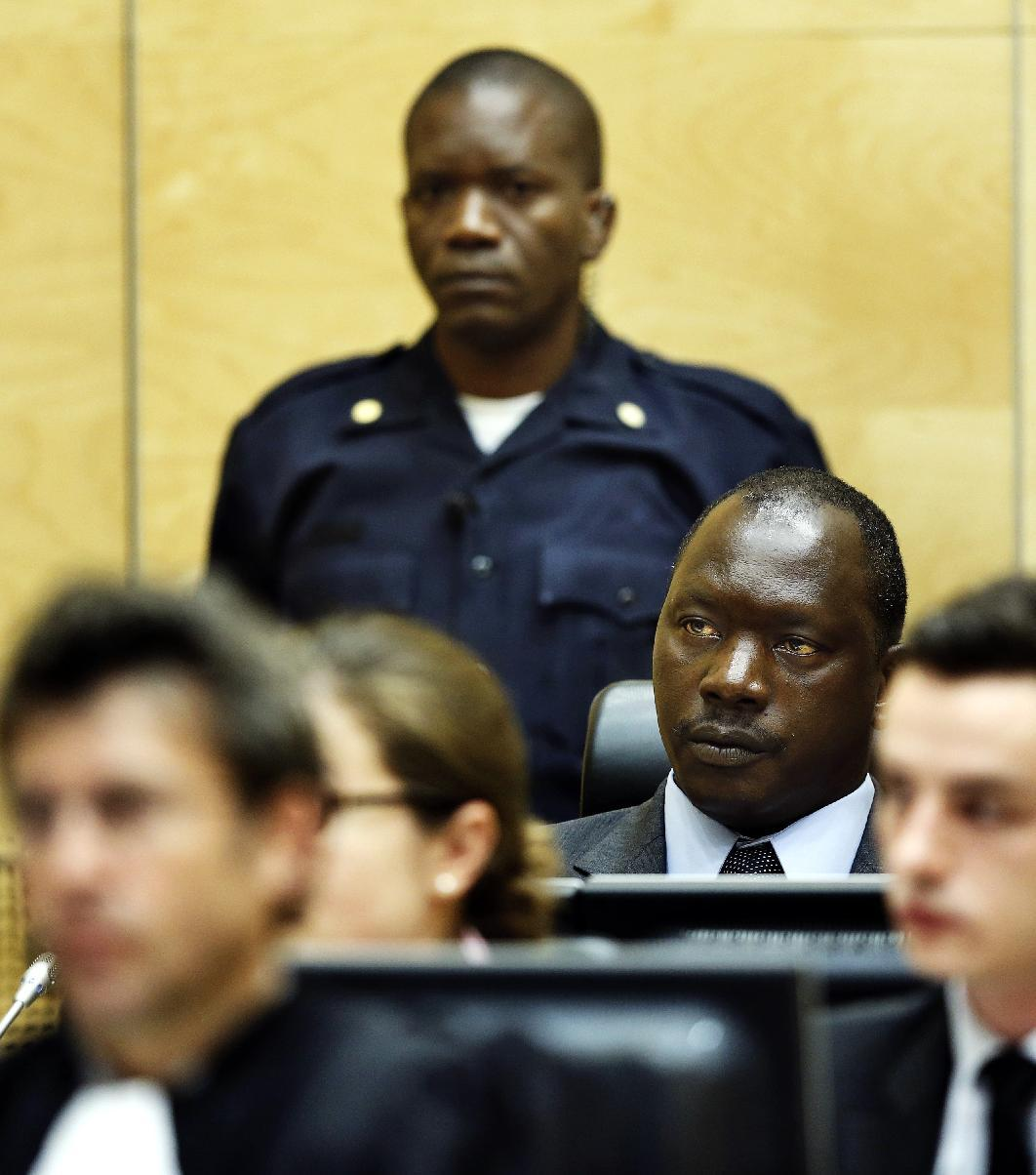 Congolese warlord Thomas Lubanga, second right, awaits his sentence in the courtroom of the International Criminal Court (ICC) in The Hague, Netherlands, Tuesday, July 10, 2012. Judges at the ICC are handing down their first-ever sentence on Tuesday, following the conviction of Lubanga in May for conscripting child soldiers. The sentencing is considered a milestone since it is the first to be issued by the permanent court in The Hague, and because it is expected to set a war crimes law precedent in awarding damages for victims. (AP Photo/Jerry Lampen, Pool)