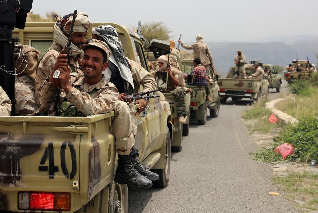 Yemeni fighters loyal to President Abedrabbo Mansour Hadi drive in the Yafa area some 180 kilometres north of the port city of Aden on August 9, 2016 (AFP Photo/Nabil Hassan)