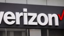 Verizon shares rise as it adds wireless customers