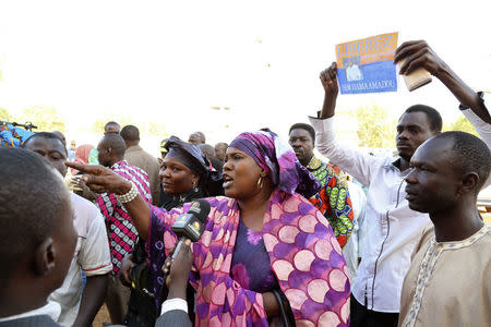 Supporters of presidential candidate Hama Amadou shout slogans outside the court of appeals building after Amadou's appeal for bail was rejected in Niamey