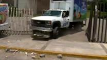 Mexican protesters hurl rocks, smash windows to mark students' disappearance
