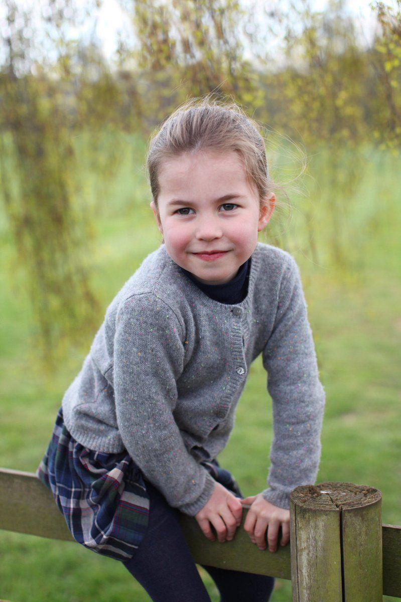 """<p>This portrait was taken at <a href=""""https://www.townandcountrymag.com/style/home-decor/a25646036/anmer-hall-prince-william-kate-middleton-george-louis-princess-charlotte-country-home/"""" target=""""_blank"""">the family's home in Norfolk</a> in April and shows Charlotte playing on the grounds of the estate.</p>"""