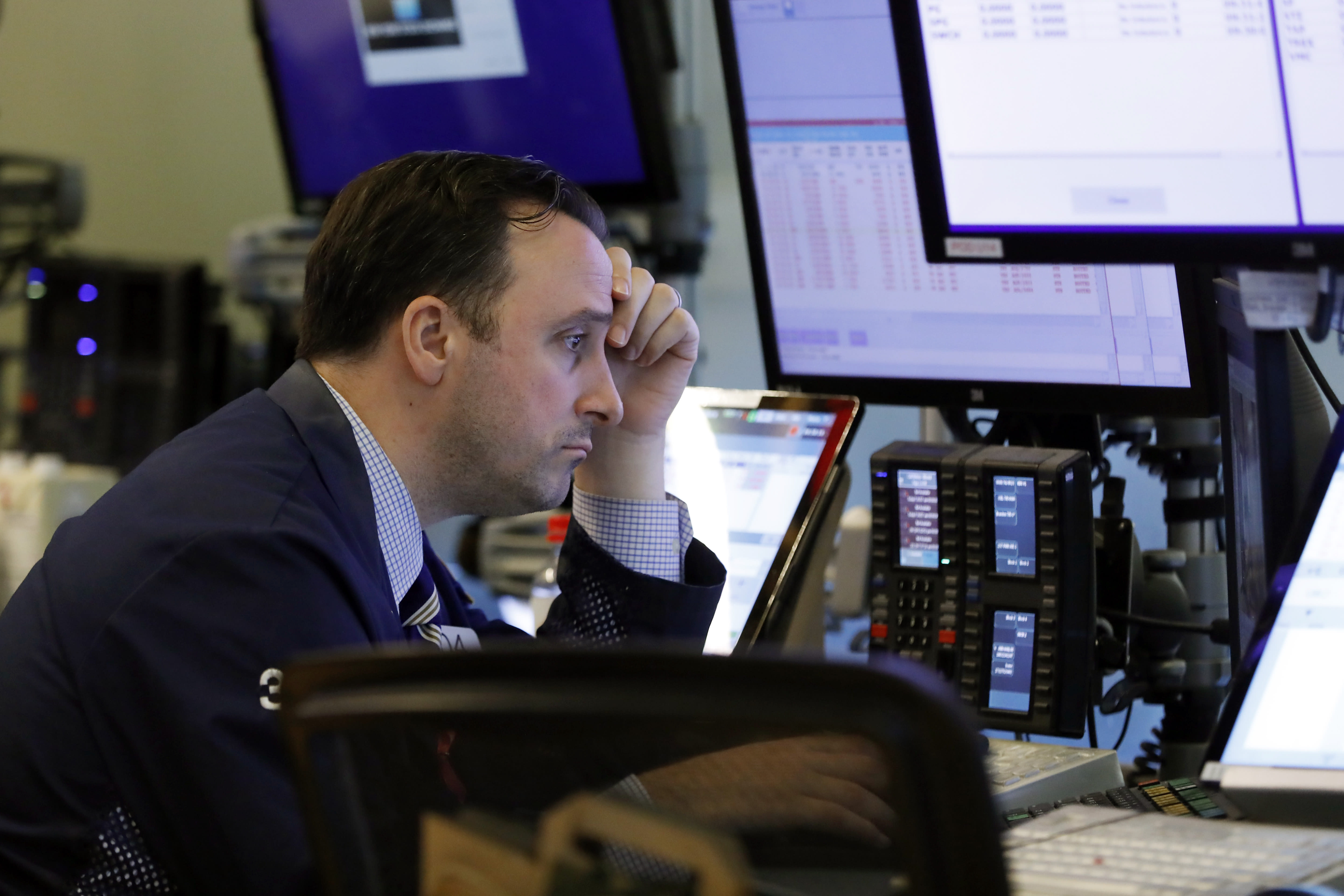 Trader Brandon Barb works on the floor of the New York Stock Exchange, Thursday, Aug. 15, 2019. Stocks are rising on Wall Street early Thursday on indications American consumers continue to spend and embrace online shopping. (AP Photo/Richard Drew)