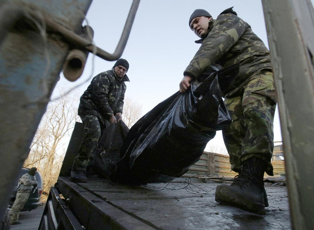 The conflict between pro-Russian rebels and government troops in eastern Ukraine has claimed more than 6,500 lives since the conflict began more than a year ago (AFP Photo/Anatolii Stepanov)
