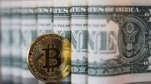 Bitcoin is a 'speculative bubble' and unlikely to become a real currency, UBS says