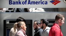 UPDATE 2-Bank of America profit beats as healthy economy fuels loan growth