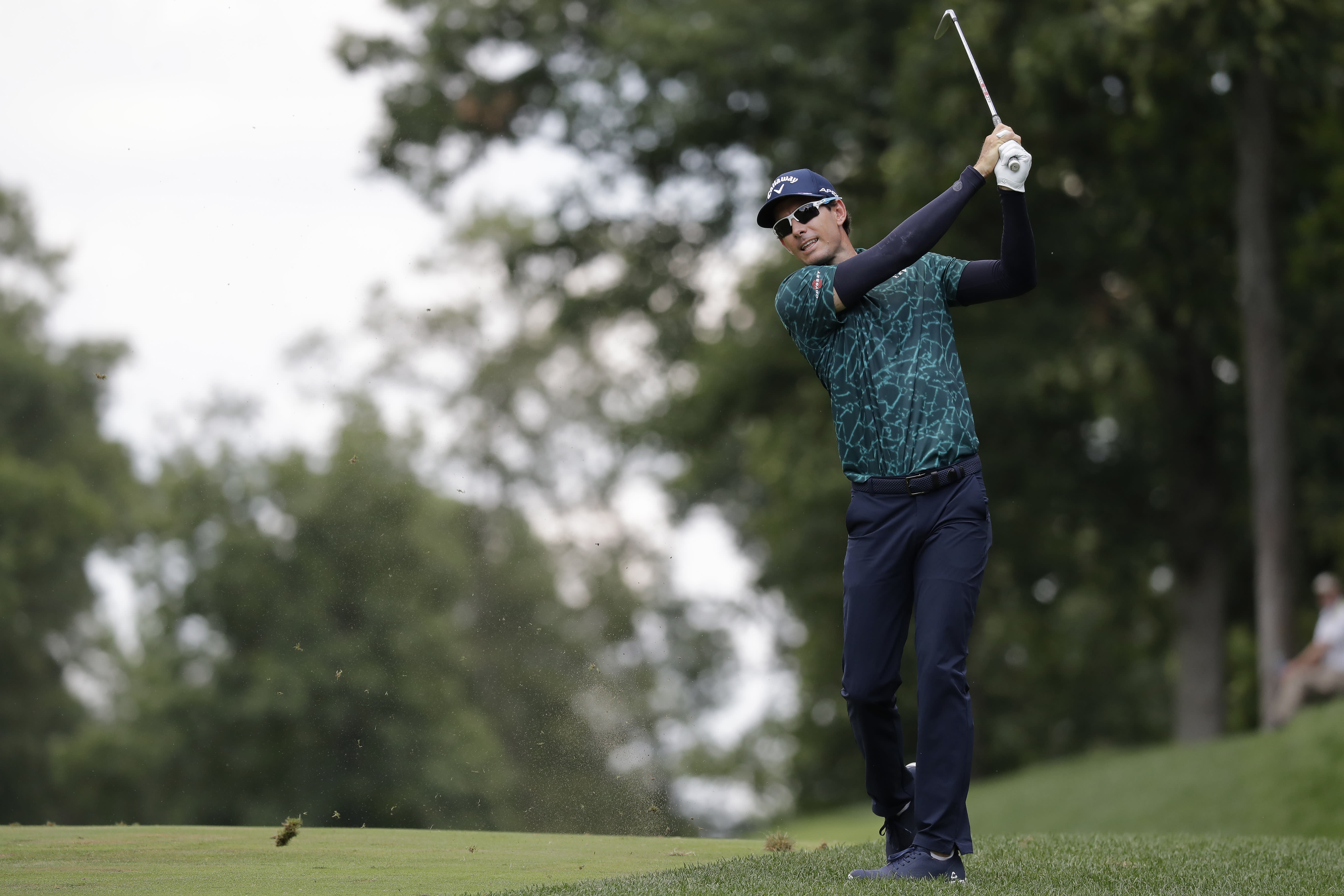 Dylan Frittelli, of South Africa, hits to the ninth fairway during the third round of the Memorial golf tournament, Saturday, July 18, 2020, in Dublin, Ohio. Frittelli, who had tested positive for the coronavirus, played Saturday without a playing partner. (AP Photo/Darron Cummings)