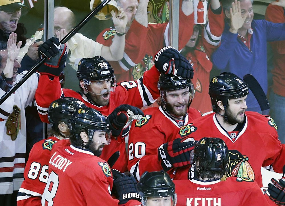 Chicago Blackhawks center Michal Handzus (26) celebrates a game winning goal with his teammates during the second overtime period in Game 5 of the Western Conference finals in the NHL hockey Stanley Cup playoffs against the Los Angeles Kings, Wednesday, May 28, 2014, in Chicago. The Blackhawks won 5-4 in the second overtime. (AP Photo/Andrew A. Nelles)
