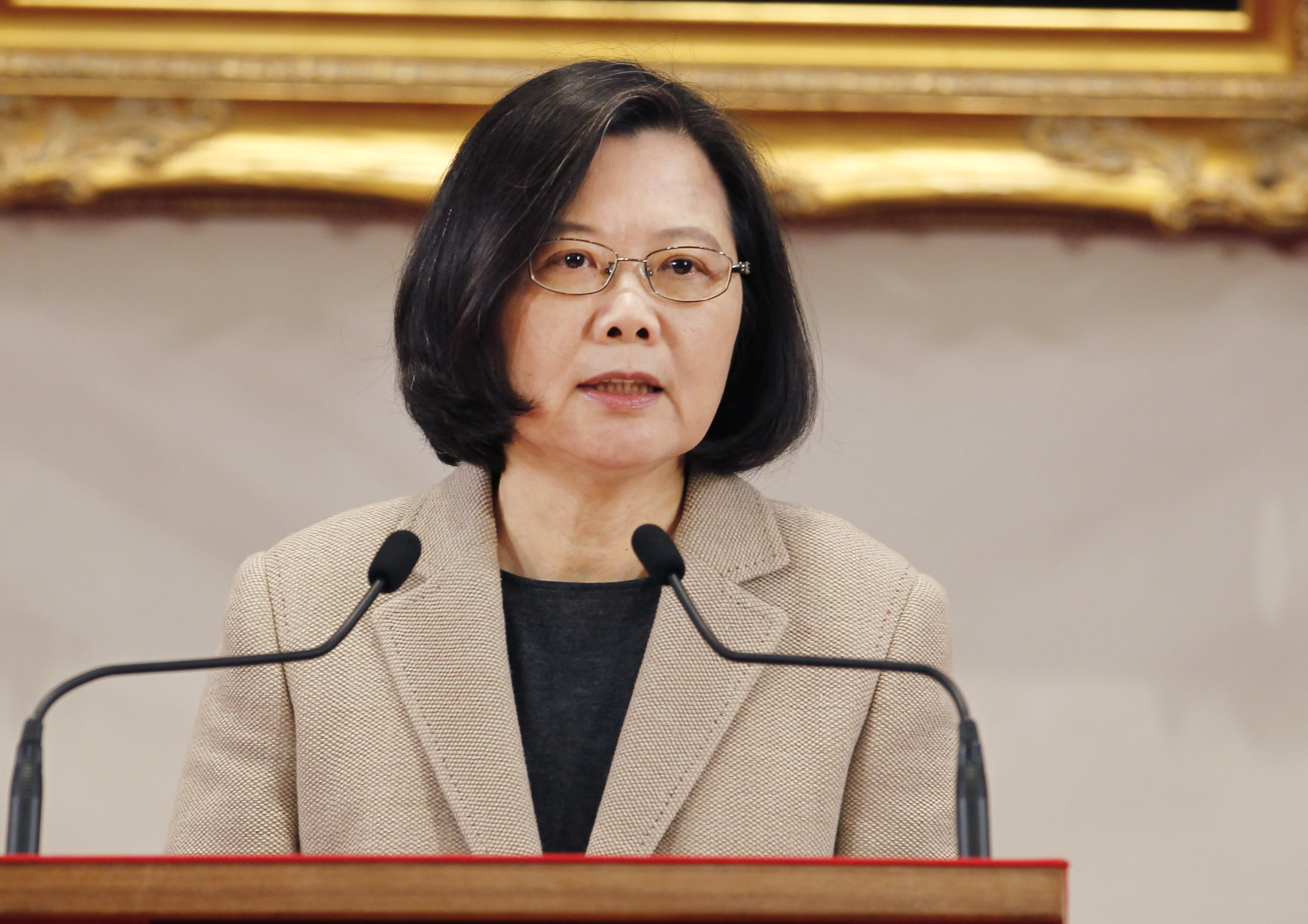 """FILE - In this Jan. 1, 2019, file photo, Taiwanese President Tsai Ing-wen delivers a speech during the New Year press conference in Taipei, Taiwan. China says attempts by Taiwan's government to block its goal of bringing the self-governing island under Beijing's control are like """"stretching out an arm to block a car."""" The new rhetorical broadside was launched late Tuesday, March 12, against Taiwanese President Tsai following her announcement of guidelines to counter China's """"one country, two systems"""" framework for political unification with the island. (AP Photo/Chiang Ying-ying, File)"""