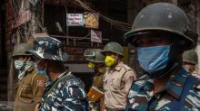 Coronavirus: India enters 'total lockdown' after spike in cases