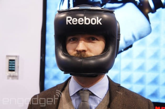 Testing Reebok's Checklight head impact monitor with a human punching bag