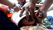 Firemen cut water pipe off baby's head in China
