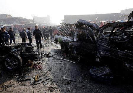 Wreckage is seen at the site of a car bomb attack at a vegetable market in eastern Baghdad, Iraq January 8, 2017. REUTERS/Wissm al-Okili