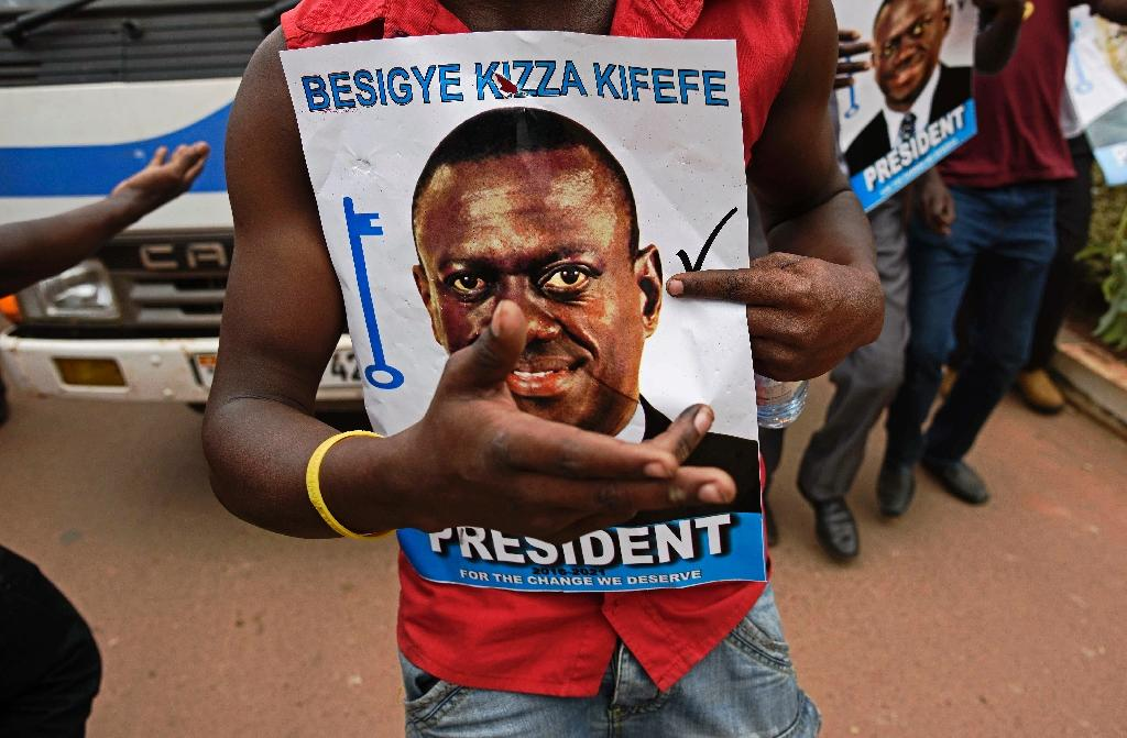 A long-standing opponent of Museveni, Kizza Besigye (pictured) has been frequently jailed, placed under house arrest, accused of both treason and rape, teargassed, beaten and hospitalised over the years (AFP Photo/Isaac Kasamani)