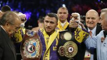 Lopez upsets Lomachenko to unify lightweight titles