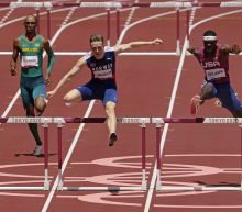 Hurdler Warholm crushes world record in race for the ages