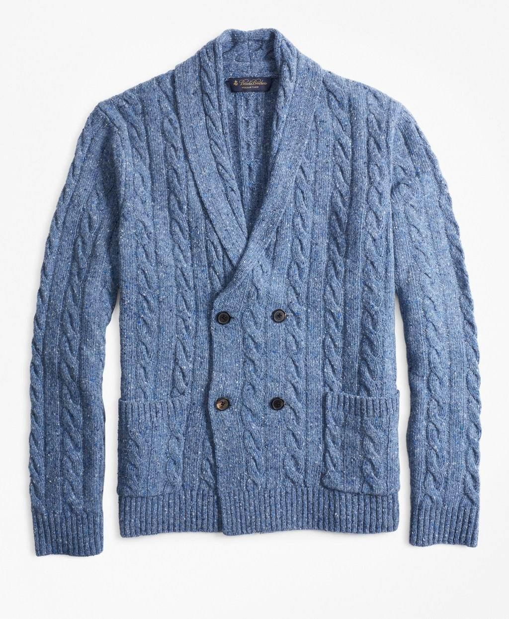 """<span>$298; buy now at <a href=""""https://www.brooksbrothers.com/Double-Breasted-Cable-Cardigan/MS00918,default,pd.html?ICID=Bestlife_MS00918"""" rel=""""nofollow noopener"""" target=""""_blank"""" data-ylk=""""slk:brooksbrothers.com"""" class=""""link rapid-noclick-resp"""">brooksbrothers.com</a></span> For a snappy and comfortable alternative to a blazer, consider the cardigan. Yes, yes, we know: cardigans scream """"stuffy""""—usually. This beauty here, though, is an exception to the rule. A double-breasted cut lends a level of gravitas that no traditional sweater can match, while a sharp shawl collar accentuates the shoulders in the same way a well-tailored suit does. And it does that all without sacrificing the coziness you'd expect from a cable-knit."""